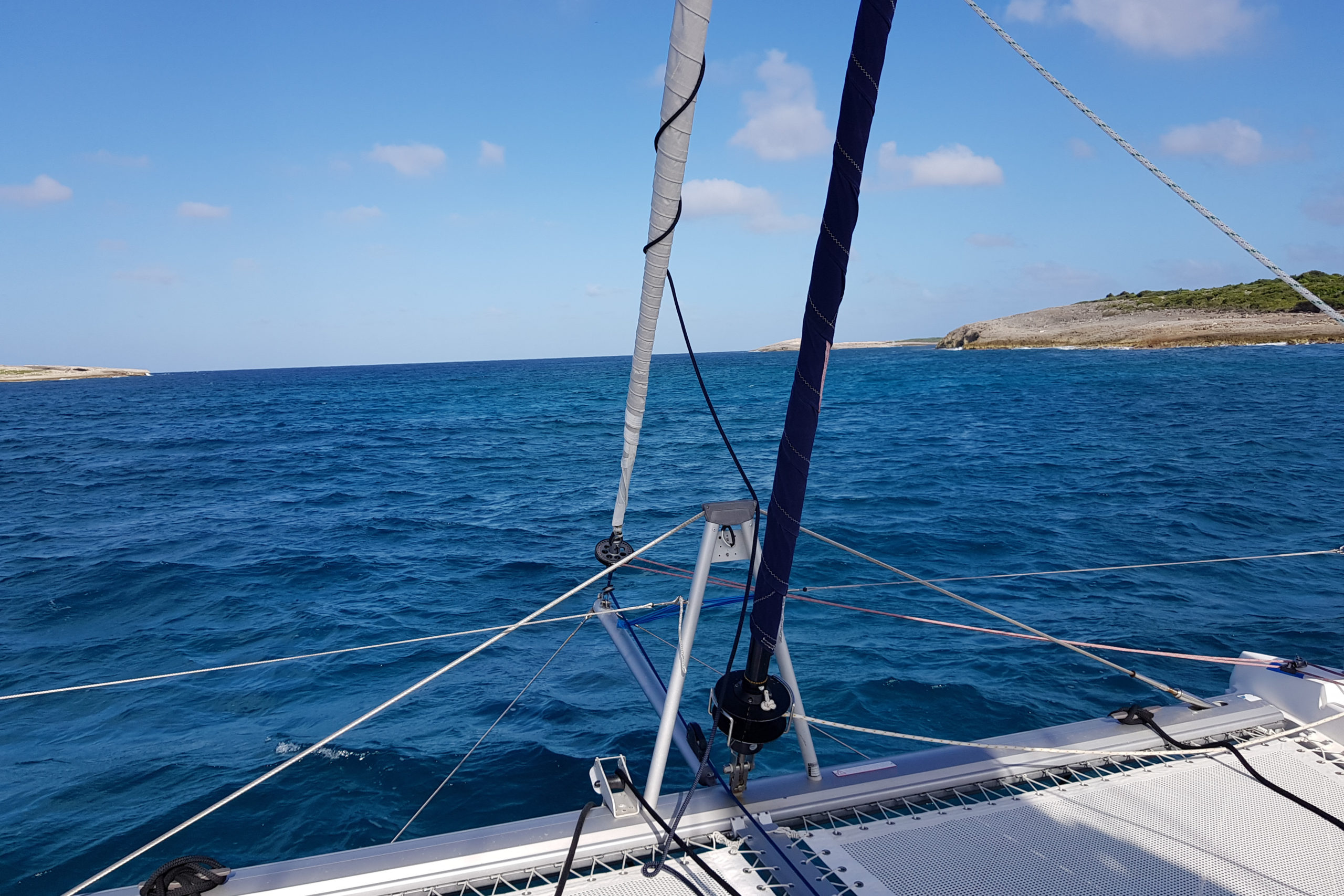 "The catamaran ""The Good Life"" sailing around Saint-Martin / Forward view with the trampoline"