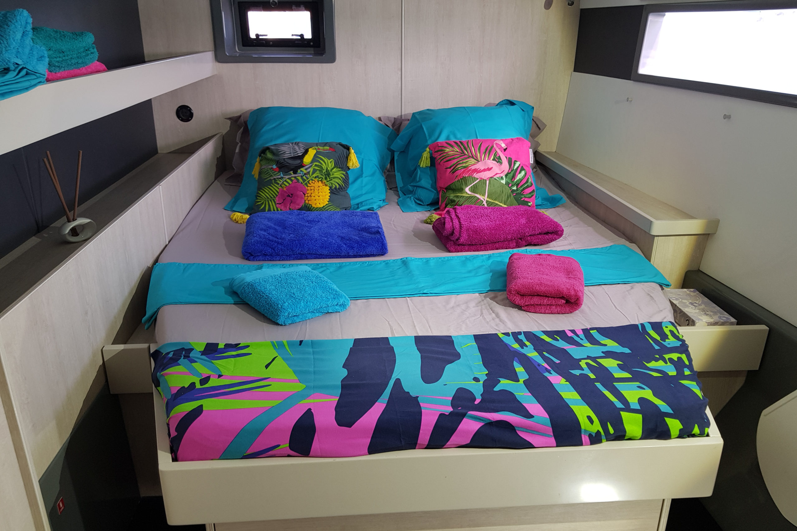 "Catamaran ""The Good Life"" - Bed in aft port cabin with towels"